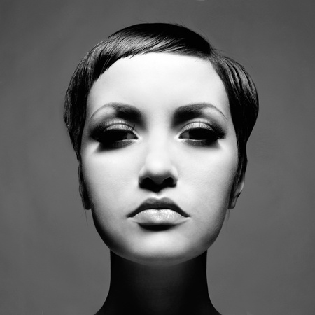 Portrait of beautiful young lady with short hair