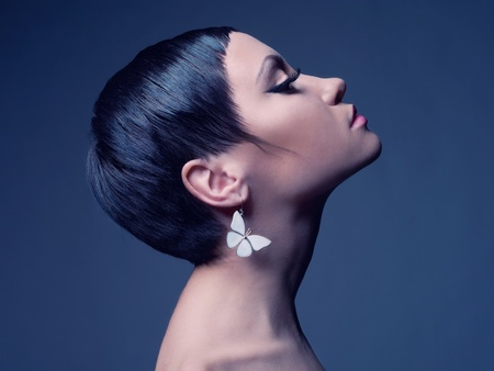 Sensual portrait of a beautiful lady with earring-butterfly Stock Photo - 13027726