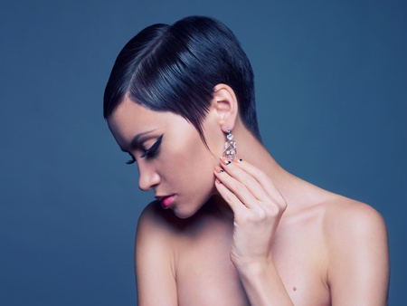 Sensual portrait of a beautiful lady with diamond earring photo