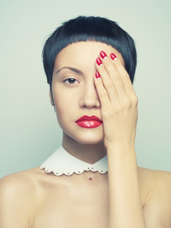 Fashion portrait of a beautiful young lady with bright nail polish Stock Photo - 13027722