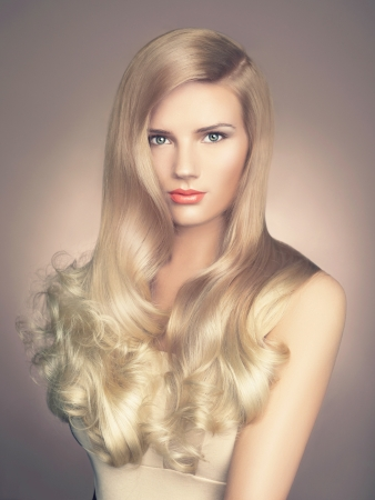 glossiness: a young beautiful lady with magnificent blond hair