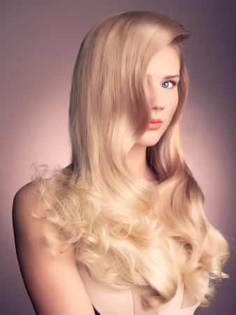 blond hair: a young beautiful lady with magnificent blond hair