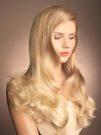 a young beautiful lady with magnificent blond hair photo