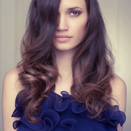a young beautiful lady with magnificent dark hair