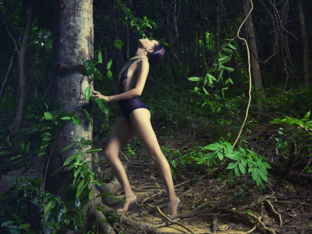 nude outdoors: Glamorous lady in a lace leotard in a tropical forest