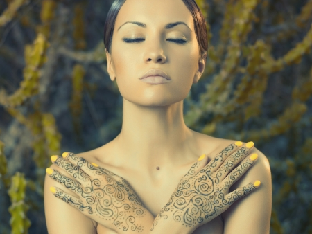 painted hands: Beautiful young lady with painted hands mehendi