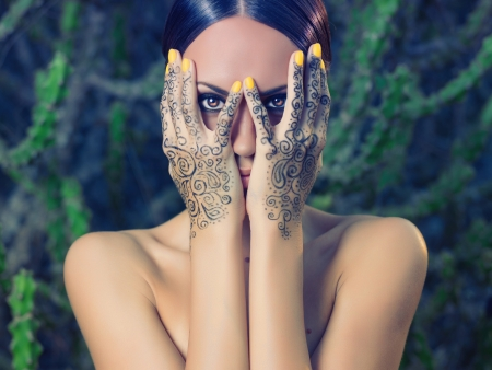 Beautiful young lady with painted hands mehendi Stock Photo - 17383507