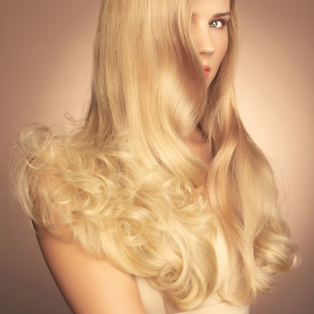magnificent: Photo of young beautiful lady with magnificent blond hair Stock Photo