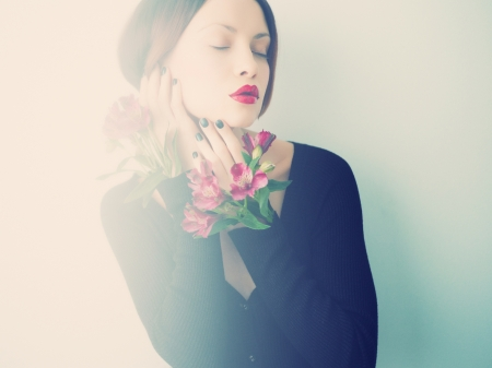 Art portrait of beautiful young lady with delicate flowers photo