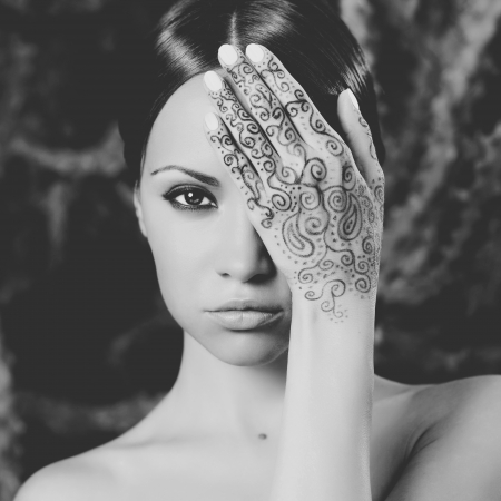 Beautiful young lady with painted hands mehendi photo