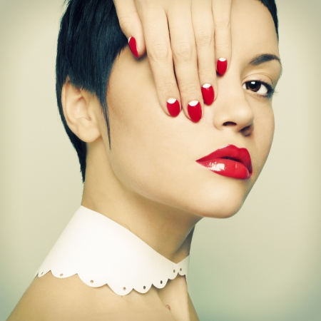Fashion portrait of a beautiful young lady with bright nail polish