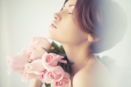 Art photo of charming young lady with roses