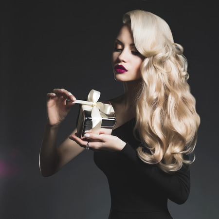 Fashion photo of luxury blonde with a gift Stock Photo