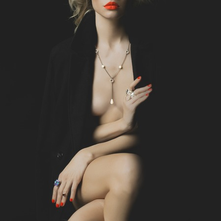 Fashion photo of a nude beauty with bright makeup and jewelry photo