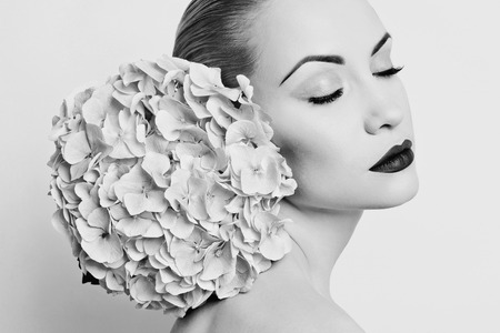 Black and white portrait of beautiful lady with hydrangea photo