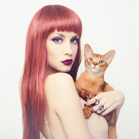 Fashionable photo of elegant lady with Abyssinian cat