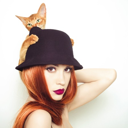 Fashion photo of elegant lady with Abyssinian cat photo