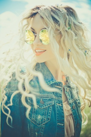 Fashion portrait of young hippie woman in summer sunny day photo