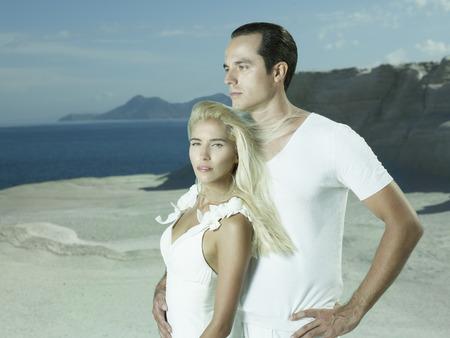 Art photo of bride and groom on the seashore. Fashion wedding photo