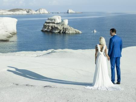 union beach: Art photo of bride and groom on the seashore. Fashion wedding Stock Photo
