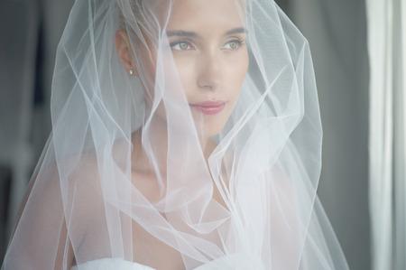 Art photo of beautiful bride waiting at the window Stock Photo
