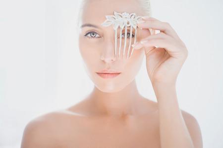 foretaste: Beautiful bride holding a comb. Fashion art photo