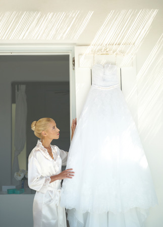 Beautiful bride looking for a dress. Fashion art photo photo