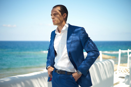 guys: Fashion portrait of handsome man in blue suit