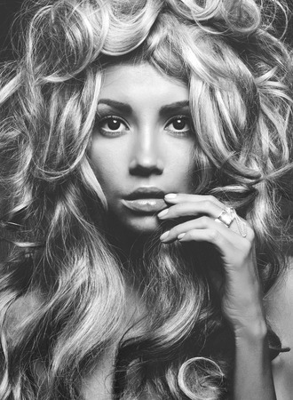 fine art portrait: Black and white portrait of eautiful woman with magnificent blond hair. Hair extension, permed