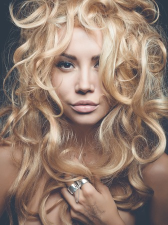 ladylike: Beautiful woman with magnificent blond hair. Hair extension, permed Stock Photo
