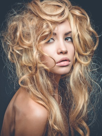 Beautiful woman with magnificent blond hair. Hair Extension, Permed Hair photo