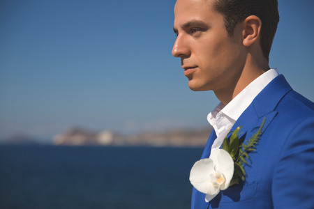 foretaste: Fashion portrait of a handsome groom in blue suit Stock Photo