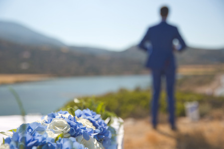 foretaste: Art fashion photo of groom waiting for the bride