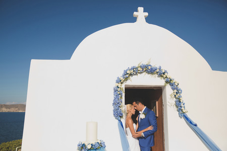 Art photo of the bride and groom in church door. Fashion wedding