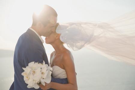 Art photo of bride and groom on the seashore. Fashion wedding 스톡 콘텐츠