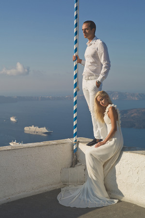 union beach: Fashion art photo of bride and groom on the seashore. Wedding Stock Photo