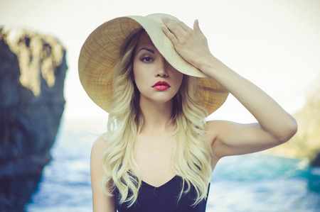 Portrait of a beautiful young lady in a straw hat Standard-Bild