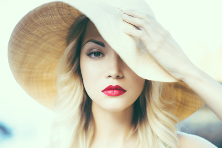 Portrait of a beautiful young lady in a straw hat Stock Photo