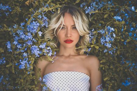 beauty model: Portrait of beautiful romantic lady in the flowered garden