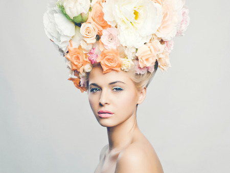 Portrait of beautiful woman with hairstyle of flowers. Fashion photo
