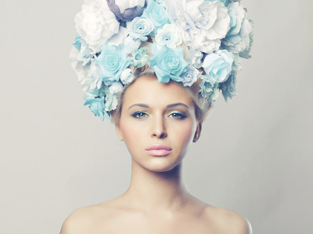 Portrait of beautiful woman with hairstyle of flowers. Fashion photo Zdjęcie Seryjne - 33443467