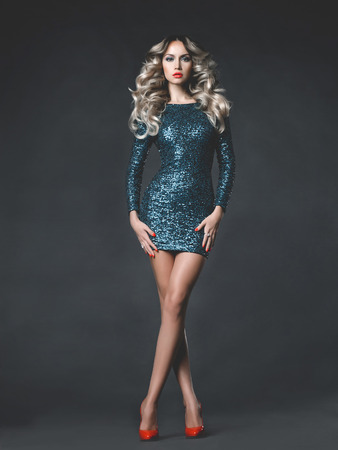 fashion girl: Fashion photo of young gorgeous woman in sequined dress Stock Photo