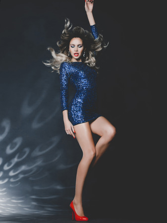 sexy woman disco: Fashion photo of dancing gorgeous woman in sequined dress