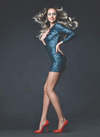 shoe shine: Fashion photo of a young gorgeous woman in festive dress