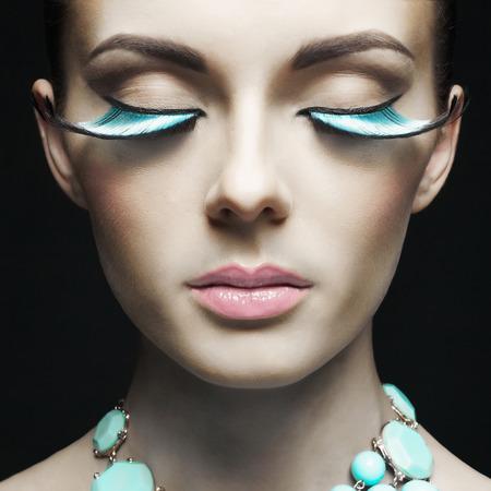 black eyes: Fashion portrait of beautiful lady with mint eyelashes and necklace