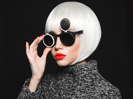 Fashion studio photo of beautiful stylish lady in sunglasses