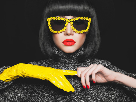 young woman face: Fashion studio photo of stylish lady in gloves and sunglasses Stock Photo