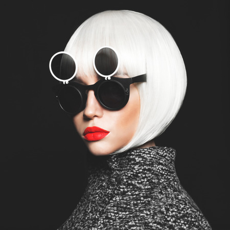 Fashion studio photo of stylish lady in sunglasses