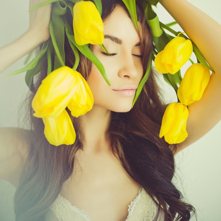 decolette: Fashion art portrait of beautiful lady with delicate flowers Stock Photo