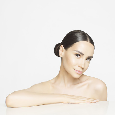 Studio portrait of beautiful young woman with perfect skin. Beauty and care. Spa salon Stock Photo